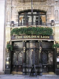 The Golden Lion Pub England - Located in the posh St James's area of London, the Golden Lion can trace its history back over three centuries. The present building is around a century old. The pub contains a Theatre Bar upstairs. British Pub, British Isles, Old Pub, London United Kingdom, Pub Signs, London Pubs, England And Scotland, Shop Fronts, London Calling