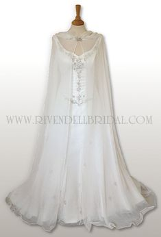 Id get the see through cape instead of a veil :)but in white. #weddingshoes
