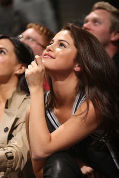 Selena watching the Spurs game.