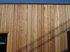 Timbersource are a leading online European Siberian Larch timber merchant in the UK. This softwood timber is particularly resistant to decay. Cedar Cladding House, Wood Cladding Exterior, Larch Cladding, Wall Cladding, Front Door Porch, Drum Room, Room Wall Painting, Timber Walls, Beach Houses
