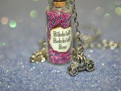 Bibbidi-Bobbidi-Boo Bottle of Magic Necklace and  3-D Pumpkin Carriage Charm Cinderella Fairy Godmother. $15.00, via Etsy.