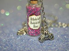Bibbidi-Bobbidi-Boo Bottle of Magic Necklace and  3-D Pumpkin Carriage Charm Cinderella Fairy Godmother. $15.00, via Etsy.