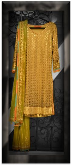 How stunning is this green and gold outfit by Kanika Kedia with resham, badla and sequinned work?