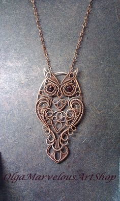 Very special owl with garnet eyes. Made of copper in wire wrap technic. 100% handmade. materials: copper, natural garnet covered with special lacquer to protect them from influence of oxygen Size is about 3.2 X 1.6 inches (80 X 42 mm) Pendant has a cotton cord with chaines. Chaines are 3.2 inces each, total lenght with cord is 29 inches (cah be ajasted on your reqest)