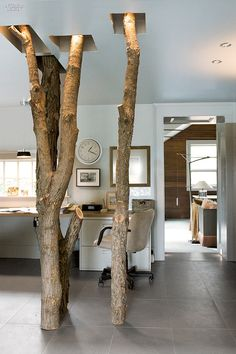 Home Run: Inside the Residences of 10 Designers | There's no shortage of trees in Ottsville, Pennsylvania, where Laura Bohn and her husband, Richard Fiori, spend long weekends away from Laura Bohn Design Associates and BFI Construction. #design #interiordesign #interiors #projects #interiordesignmagazine #home #homeoffice #residential @laurabohndesign