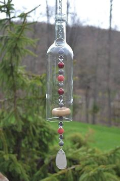 Simple DIY Garden Decor Ideas on a Budget - Wind Chimes - Beads - . Simple DIY Garden Decor Ideas on a Budget – Wind Chimes – Beads – Wine Bottle Chimes, Glass Bottle Crafts, Wine Bottle Art, Glass Bottles, Wine Bottles, Wine Bottle Cutting, Cutting Bottles, Wine Bottle Garden, Wine Art