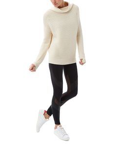 Discover the ultimate oversized chunky knit for off-duty styling. With a funnel neck and asymmetric seamline for a high fashion aesthetic. The extra soft merino blend knit provides insulating warmth, and a loose fit and dropped hem creates a comfortable fit. Thumbholes on each cuff further insulate against the cold.