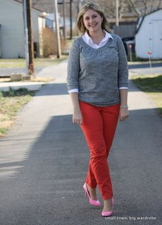 A neutral sweatshirt is dressed up with orange pants and bright pink heels