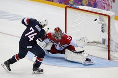 Photos of the day from 2014 Sochi Winter Olympics - February 15, 2014 -- Team USA's T.J. Oshie scores on the team's sixth shootout attempt against Russia's goalie Sergei Bobrovski during their men's preliminary round ice hockey game at the Sochi 2014 Winter Olympic Games. (REUTERS/Grigory Dukor)