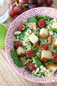 spinach quinoa salad with roasted grapes, pears and almonds