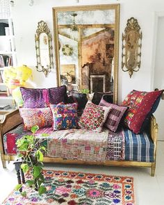 Love this layering of colours and textiles