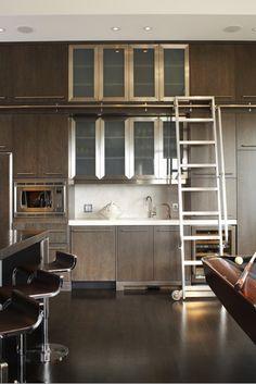 ladder + metal detail in contemporary kitchen by brian gluckstein