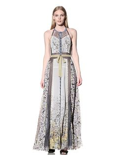 Mixed Floral Printed Maxi DressMORE DETAILSLightweight semi-sheer chiffon in varying floral patterns, solid under layer, sheer lace trim, rounded neckline, racerback styling, front button closure, attached self-tie belt  $270