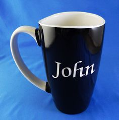 The Crystal Shoppe - Monogrammed Black Ana Curved Ceramic Funnel Mug, $11.95 (http://www.thecrystalshoppe.com/monogrammed-black-ana-curved-funnel-mug/)