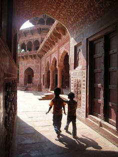 Inside the Taj Mahal, Agra. On either side of the Taj Mahal stand two red stone mosques, whilst standing in the archway I spotted these two boys singing away. Agra, Mosque, Taj Mahal, Louvre, Building, Boys, Travel, Baby Boys, Viajes