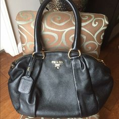 Prada Shoulder bag 🎉weekend sale! Supple leather shoulder design with signature logo detail. Gold hardware. One inside zip pocket. Two inside open pockets. Fully lined. Includes dust bag and authenticity card. Medium size, black color. (It has a little tear)inside. Great Great condition! Prada Bags Hobos