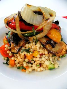 Couscous salad topped with grilled veggies