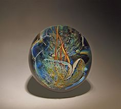 Grotto paperweight-Robert Burch-Using glass colored with silver and gold, Burch applies multiple layers of glass to create this underwater scene which magically captures the beauty of the ocean floor. Each piece will very slightly as they are each produced individually.