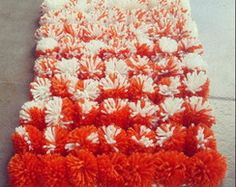Alfombra de pompones de lana