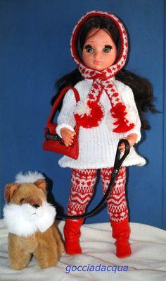 Susanna a spasso sulla neve con il suo chow.chow indossa un repro di 'Saint Moritz' 1955