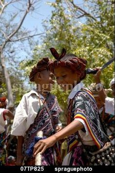 Boys wearing traditional dress including ikat weaves and beads,  and dancing, Oecussi-Ambeno, East Timor stock photo