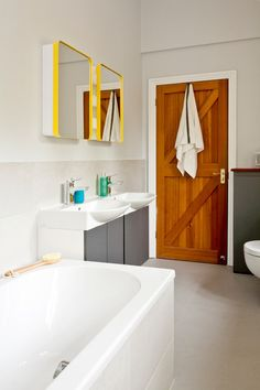 bright simple mirror with a pop of color. Rounded lip edge. Modern Bathroom by InStil Design Limited