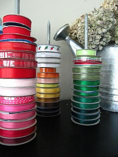 Organized Ribbon Spools with 12 Inch spikes.  They are free standing and can be on any surface and moved easily.  Great idea if you use a lot of ribbon and you have a craft/gift wrapping table ~ Iridescence.