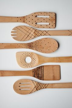 I'll go on record saying there's no such thing as having too many wooden spoons. For gifts this season, you can buy a hand-carved version or carve your own, but there's a third option you may not have thought of: etched wooden spoons!