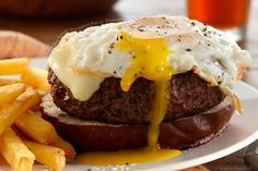 prime beef burger on a pretzel bun with Hermiker cheddar and fried egg. I have never had an egg on a bagel but I'm definitely willing to try... Pretzel Rolls, Pretzel Bun, Egg Burger, Bacon Cookies, Prime Beef, Prime Rib, Beef Burgers, Cheddar, Wrap Sandwiches
