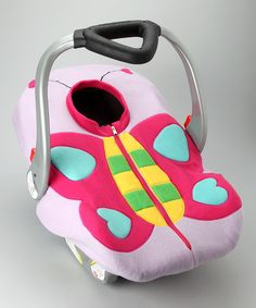 When nestled in this fleecy soft car seat cover, Baby will transform into a beautiful butterfly. This handmade cover features a zipper front and an elastic band that easily fits around most infant car seats. It's an irresistibly sweet addition to Baby's already charming allure, and a smart choice for strolls in cold weather.22'' W x 33'' D100% polyester