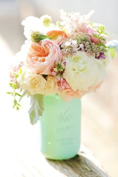 DIY Mint Seafoam sprayed paint painted wedding mason jars decoration pink peach white green yellow pastel centerpiece | @Bonnie S. S. Story Wedding