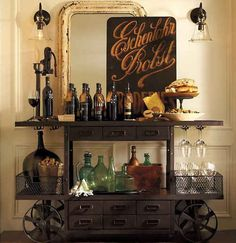 You can turn your bar cart into a mini-speakeasy with vintage bottles and art. | 19 Ways An Industrial Bar Cart Can Improve Your Life