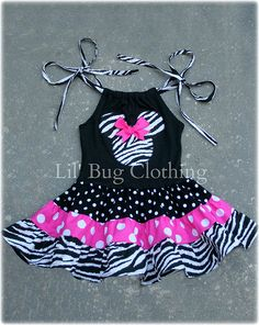 This is tooooo cute also....Custom Boutique Clothing Tiered Minnie Mouse by LilBugsClothing, $42.00