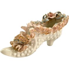 This sweet High-Heeled Porcelain Lace Shoewas made by Heirlooms of Tomorrow of Southern California. The shoe is fashioned in the style of the French Aristocracy of hundreds of years ago.  Delicate,