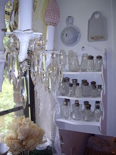 collection of crystal salt shakers    other side of kitchen window with crystal shakers