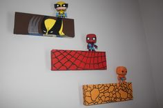 wicked cute idea. Cover blocks of wood with character fabric, then put the toy above/on.