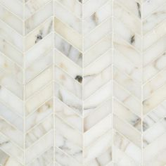 """Product Attributes - Item: Premium (SELECT) Quality 10.75"""" X 12.25"""" Mini Chevron Italian Calacatta Gold Marble POLISHED OR HONED MOSAIC TILE (ON-MESH) Dimensions (per piece): 10.75"""" (Width) X 12.25"""" (Length) X 1/4 x 3/8"""" (Thickness) Material: Premium Italian Calacatta Gold Marble Coverage: 1 Sheet = 1 Sq. Ft. Application Area(s): Commercial and Residential (Interior & Exterior), Indoor, Outdoor, Shower, Countertop, Backsplash, Bathroom, Kitchen, Deck & Patio, Decorative, Floor, Wall…"""