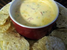 This is a delicious cheese dip that my daughter makes.  The cream cheese gives it a wonderful consistency. All the fresh ingredients make this a dip that you will be asked for over and over again! Please note I have put to taste on alot of the ingredients as it depends on how big your bunch of veggies are.  If you actually get lucky enough to have any left it keeps in the fridge a good while and reheats great. I usually serve/take this dip in a crockpot so it stays warm.