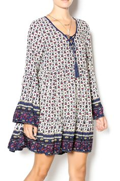 Bohemian border print dress with slight bell sleeve and tie front tassels. We love this 3 season dress. Pair with boots and leggings and bring this look right into Winter. Bohemian Border Print Dress by En Creme. Clothing - Dresses - Floral Clothing - Dresses - Long Sleeve Clothing - Dresses - Casual Clothing - Dresses - Printed Pennsylvania