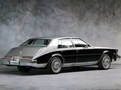 """In the '80s, Cadillac becomes the first automaker to use integrated microprocessors to control ignition, fuel injection and diagnostics. Around the same time, the brand was rated number one in customer sales satisfaction by J.D. Power. This 1981 Seville Elegante Sedan has the classic """"bustle back"""" style trunk. Even in the '80s, this must've looked old fashioned."""