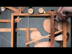 Japanese Artist Creates Playfully Bizarre Hand-Cranked Wooden Automata