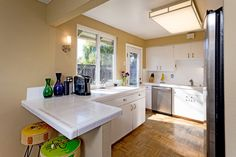 The kitchen is bright and inviting with plenty of counter space and a breakfast bar.
