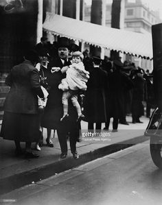 Albert Spencer, 7th Earl Spencer (1892 - 1975) with his son Edward John Spencer at the wedding of the Marquis of Hamilton and Lady Kathleen Crichton at St Martin-in-the-Fields, London, February 1928. Edward John, later the 8th Earl Spencer, was one of the pageboys at the wedding. He would grow up to father Diana Spencer, the Princess of Wales.