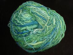Pacific Parrotlet hand-spun yarn by Jungrrl