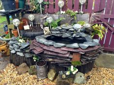 Raised pond and bog garden. Constructed from used tyres slate and pallets.