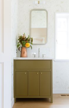 One of our favorite details: a built-in vanity in the front powder room, painted in Sherwin-Williams Mossy Gold. The vintage copper pitcher belongs to Palminteri& Olive Green Bathrooms, Hygge And West, Built In Vanity, Small Vanity, Bathroom Lighting Design, Design Bathroom, Interior Lighting, Lighting Ideas, Bathroom Furniture
