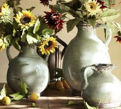 Hand‐formed terra cotta is glazed a soft, eggshell blue and then distressed at the rim and base to look like found antiques. Display real flowers or any of our realistic faux botanicals in these watertight vessels