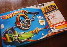 Name: Hot Wheels Wall Tracks Price: $29.99  Rating: Recommend   Growing up I didn't have Barbies, I had Hot Wheels. I used to spend hours with my brother and cousins as we set up tracks and raced cars all day long. When the day came to a close we'd have to pack everything back up so you could see the living room floor. This latest product from America's favorite toy car company eliminates that last step and keeps things out from under foot and secured to the wall. It wasn't all butterflies…