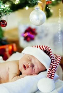 Christmas baby portrait, newborn portrait. This is not a backdrop, we used a real Christmas tree!