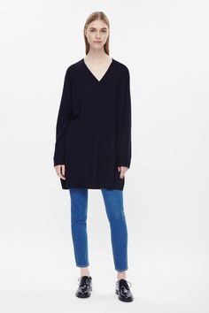 Made from a soft merino wool with a slight heer finish, this oversized dress has…